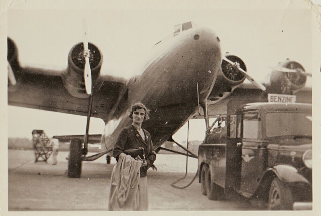 Holland Benzine war time airplane Fueling Woman Intrigue