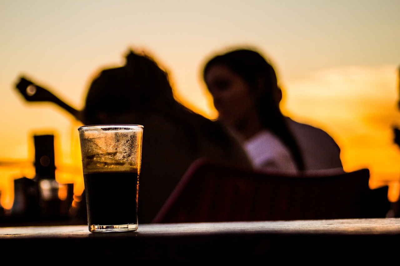 Glas in Front of people, with sunset. #girls #glas #cafe # #marokko #tea #two Girls Adult Adults Only Alcohol Business Day Drink Drinking Glass One Man Only One Person Outdoors People Refreshment