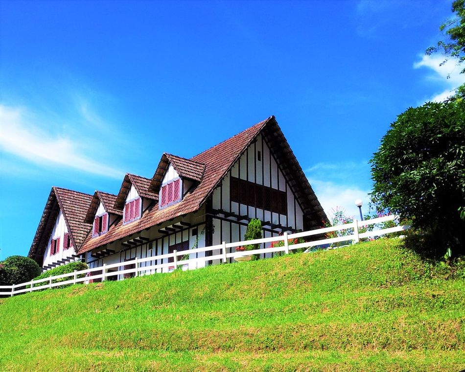 Architecture Blue Building Exterior Built Structure Cameron Highlands Cameronhighlands Cottage Day Grass Low Angle View Nature No People Outdoors Sky Smoke House Travel Destinations Tudor