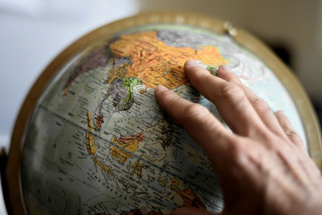 Hand on Globe Adult Business Close-up Commerce Day Globe Human Body Part Human Hand Indoors  International Map One Person People Politics Searching Small Trade Travel Vacation World