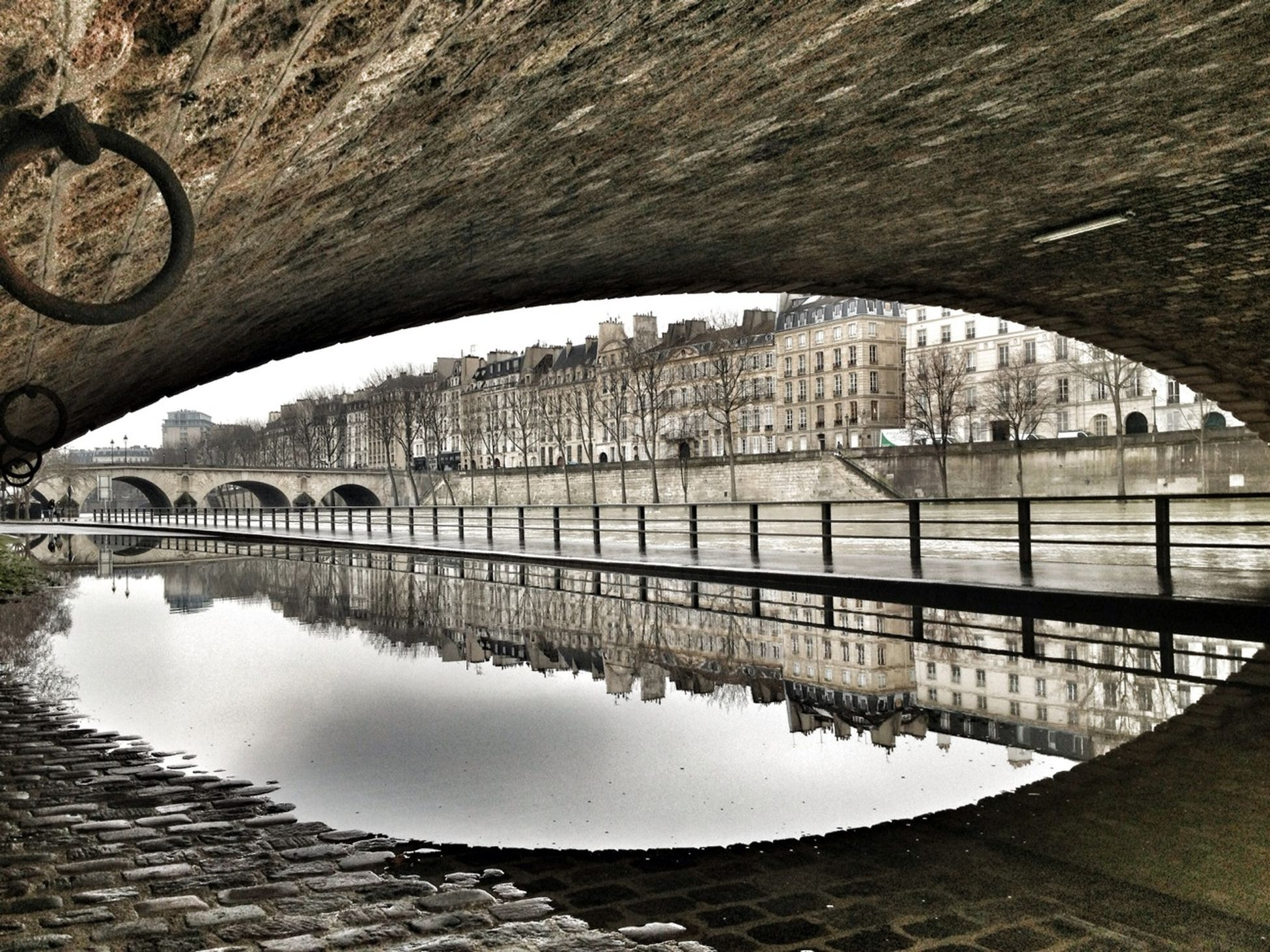 architecture, built structure, arch, building exterior, connection, arch bridge, bridge - man made structure, river, bridge, reflection, city, arched, water, transportation, engineering, day, outdoors, archway, sky, travel destinations