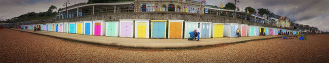 All the colours of summer are here! The beach gut in Britain... Eyemphoto Colour Of Life Colours Of Summer Beach Beach Huts Beach Hut Clouds And Sky Outdoors Dorset,England Colours England Dorset July Lyme Regis Pastel Pebble Beaches Panorama Panoramic Photography Samsung Galaxy S6