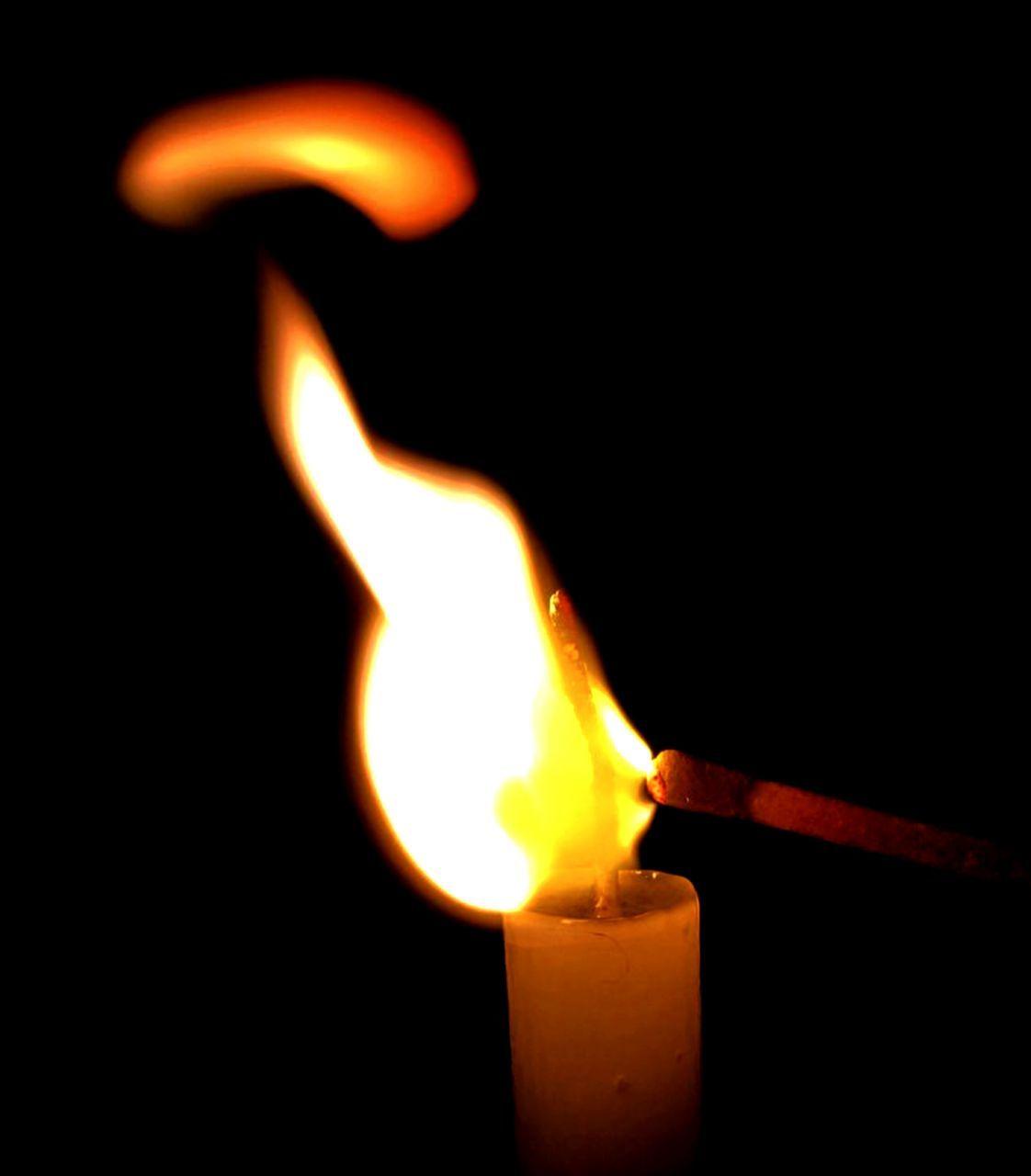 flame, burning, heat - temperature, glowing, illuminated, no people, indoors, close-up, black background, night