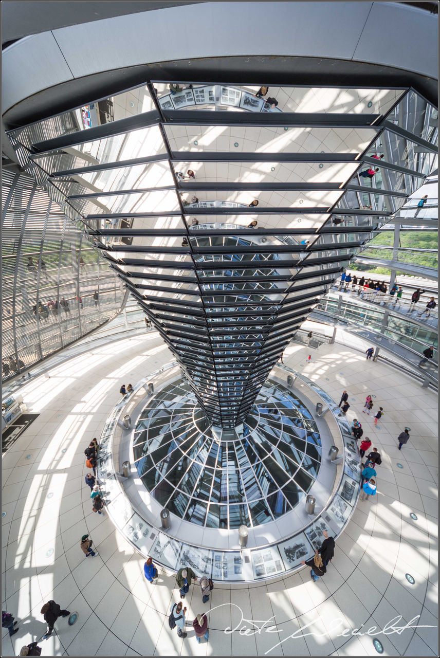 high angle view, architecture, large group of people, built structure, indoors, futuristic, day, city, people
