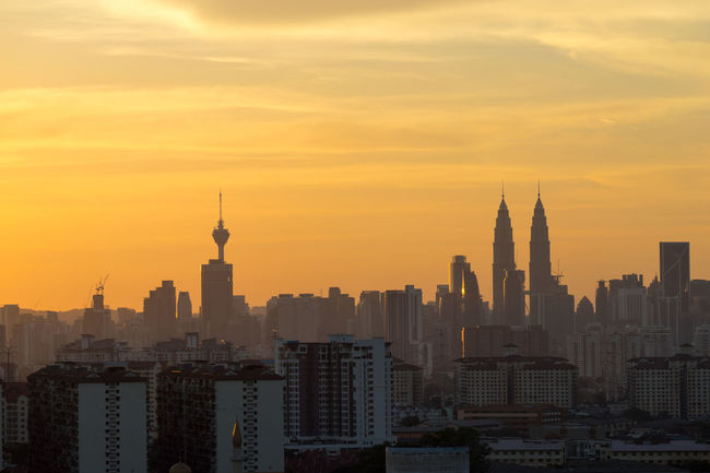 sunset in downtown kuala lumpur Architecture Building Exterior Business Finance And Industry City Cityscape Day Horizontal KL TOWER KLCC Tower KLCC Twin Towers Kuala Lumpur Malaysia  Modern No People Orange Color Outdoors Petronas Towers  Petronas Twin Towers Scenics Sky Skyscraper Sunset Tower Travel Travel Destinations Urban Skyline