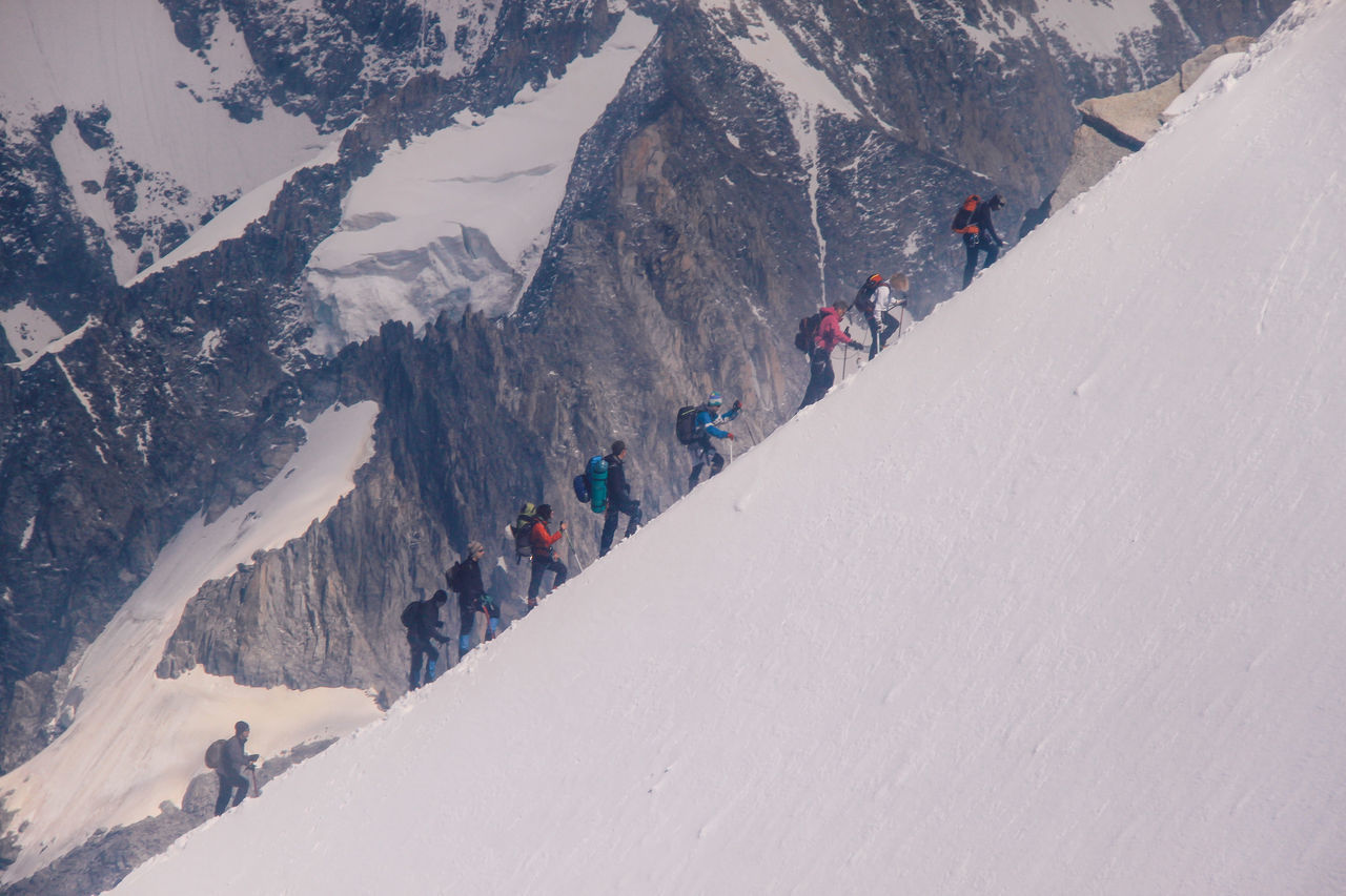 snow, winter, cold temperature, nature, weather, mountain, day, large group of people, leisure activity, lifestyles, beauty in nature, physical geography, real people, adventure, outdoors, snowcapped mountain, landscape, vacations, scenics, men, ski holiday, sky, people, adult