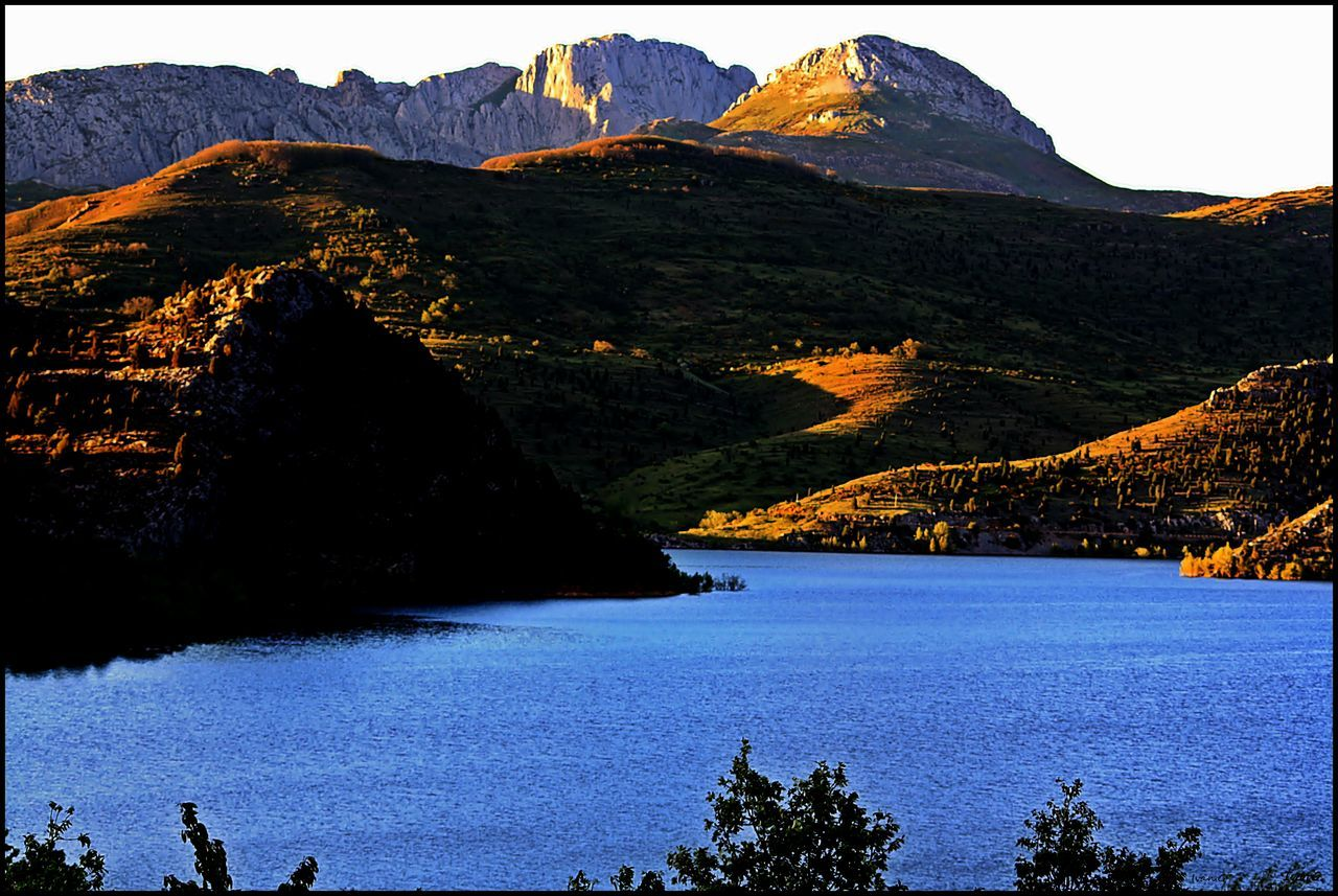 mountain, scenics, beauty in nature, tranquility, tranquil scene, nature, mountain range, water, no people, outdoors, day, sky
