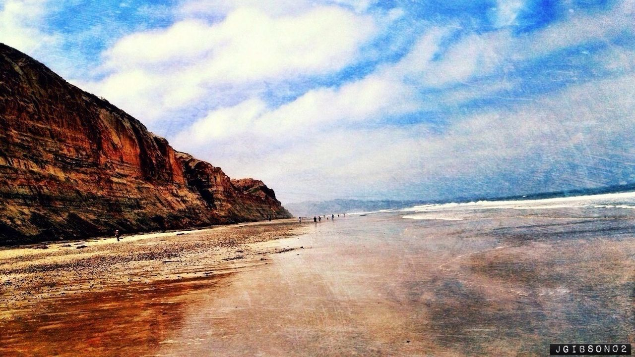 outdoors, sky, tranquil scene, tranquility, scenics, cloud, beauty in nature, sea, nature, sand, blue, copy space, horizon over water, water, non-urban scene, geological formation, coastal, coastline, seashore, shore, dune, sand, shoreline, atmosphere, sky, sunlight, carbon, gases, molecules, gas, gaseous, butte, hill, sloping, fluid, liquid, viscosity, object, tangible, geology, physical geography, rough, power in nature, majestic