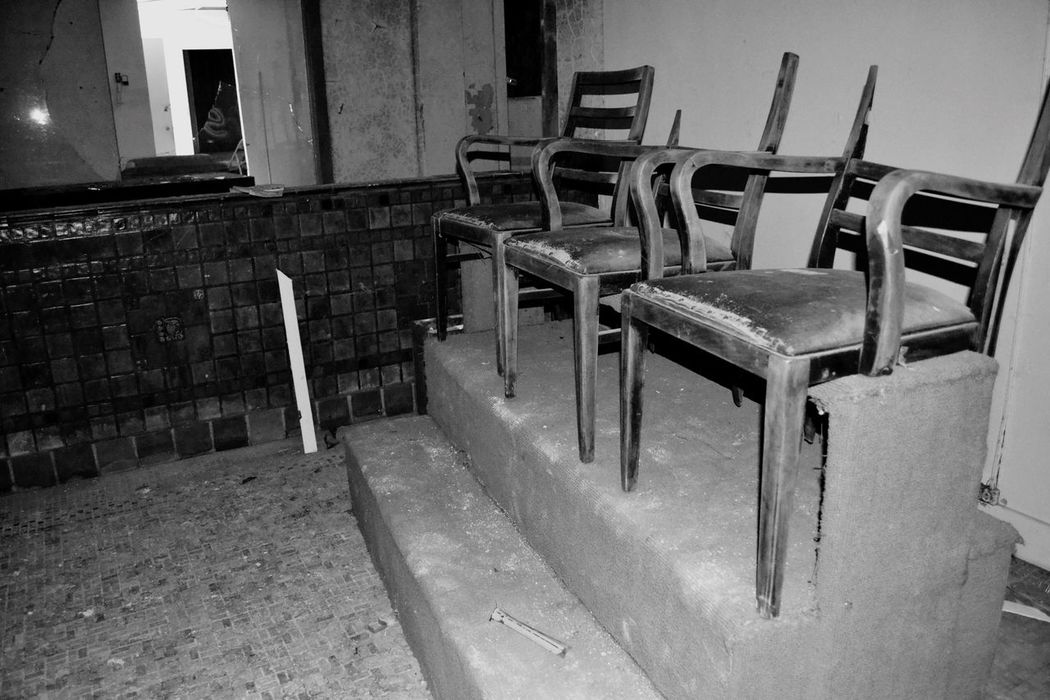 Old shoe shine station in the abandoned Baker Hotel. Chair Empty Absence Indoors  Built Structure Architecture No People Group Of Objects Order Large Group Of Objects Vintage Old-fashioned Nostalgia Abandoned Baker Hotel Mineral Wells TX