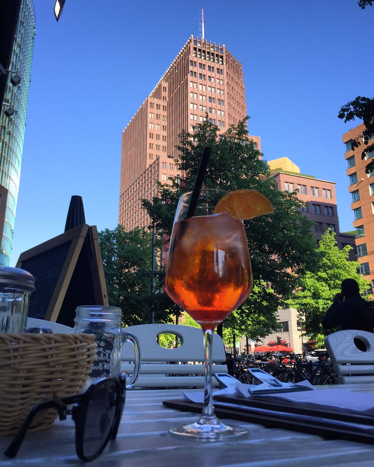 Aperol in Berlin Potsdamer Platz Architecture Building Exterior Built Structure Outdoors No People Clear Sky Tree Land Vehicle Day City Sky Freshness Berlin Photography Potsdamer Platz Aperol Spritz Spring