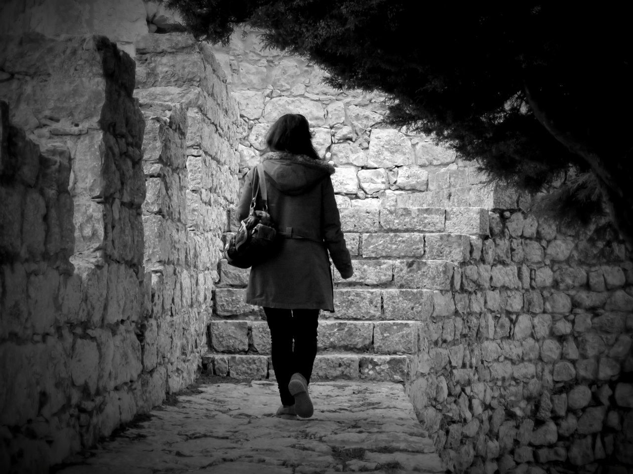 Rear View Of Woman Walking At Old Ruin Castle