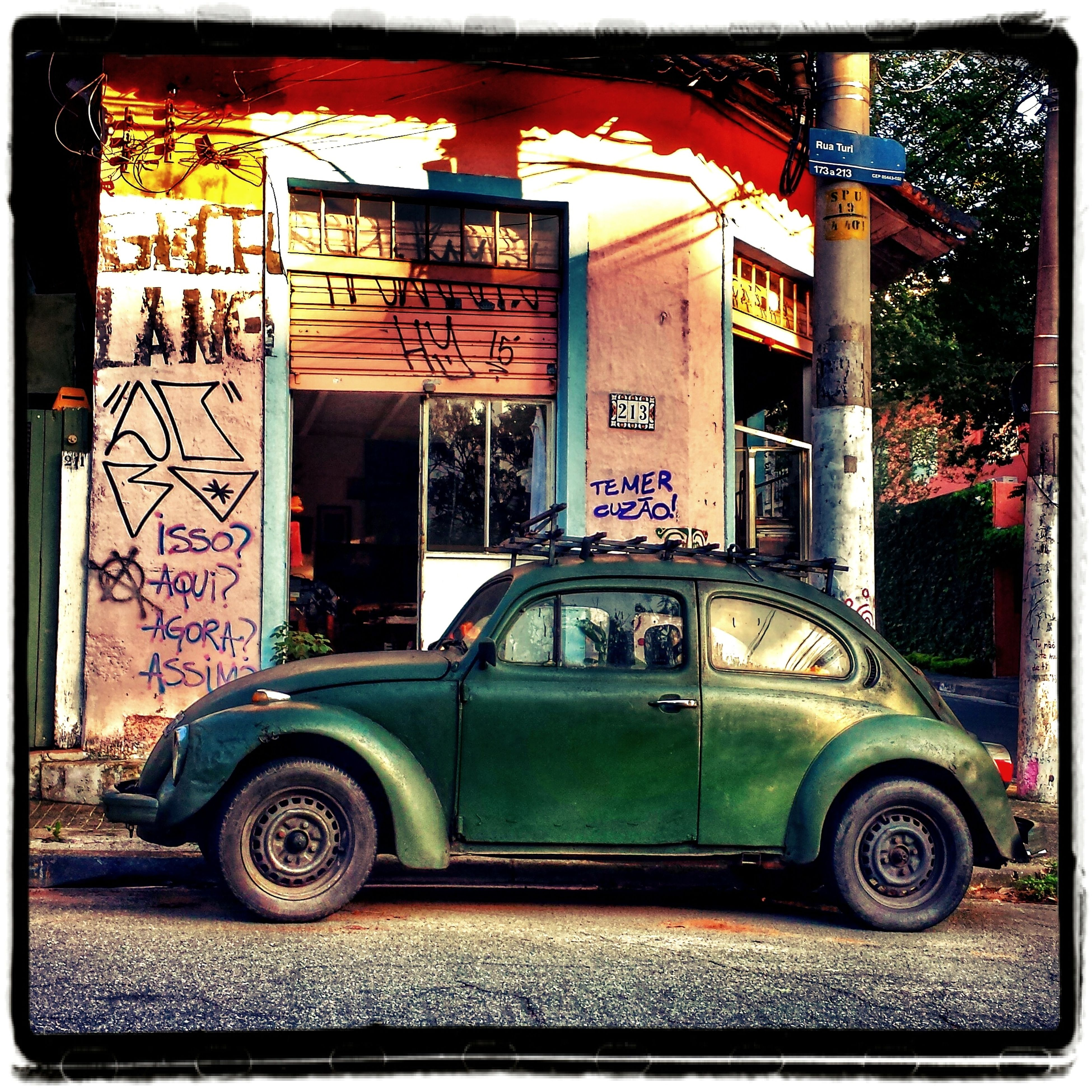 car, old-fashioned, text, no people, city, outdoors, day, architecture