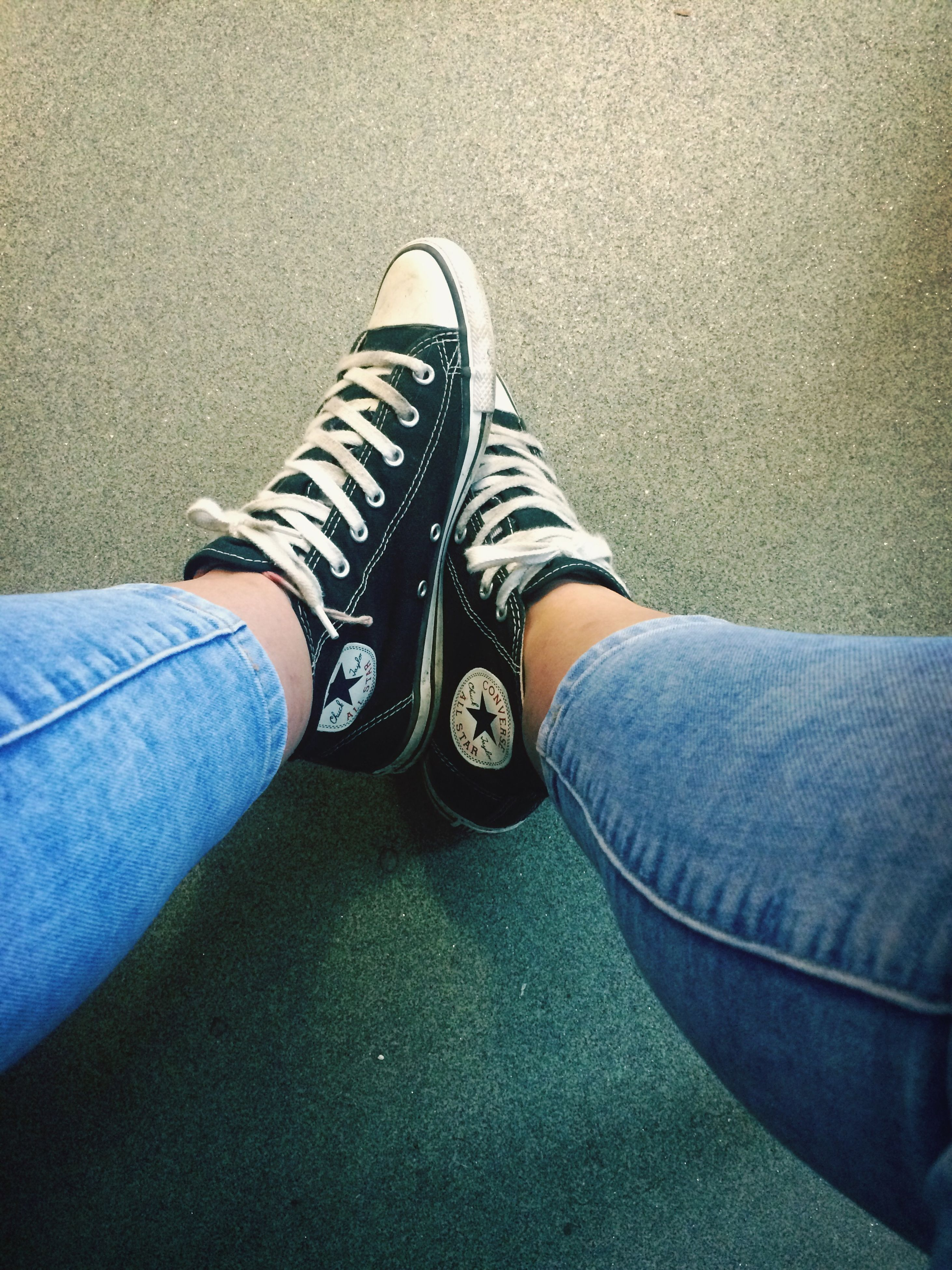 low section, person, shoe, jeans, personal perspective, footwear, lifestyles, human foot, high angle view, leisure activity, standing, sitting, casual clothing, relaxation, men, canvas shoe, street