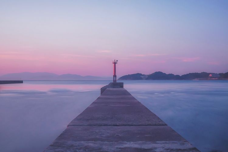 Lighthouse of Kashima, Hōjo, Ehime. Long Exposure Lighthouse Japan Purple Japan Lighthouse Sunset Sky Tranquil Scene Beauty In Nature Scenics Water Tranquility Nature Outdoors No People Sea Built Structure Mountain Architecture Day The Graphic City