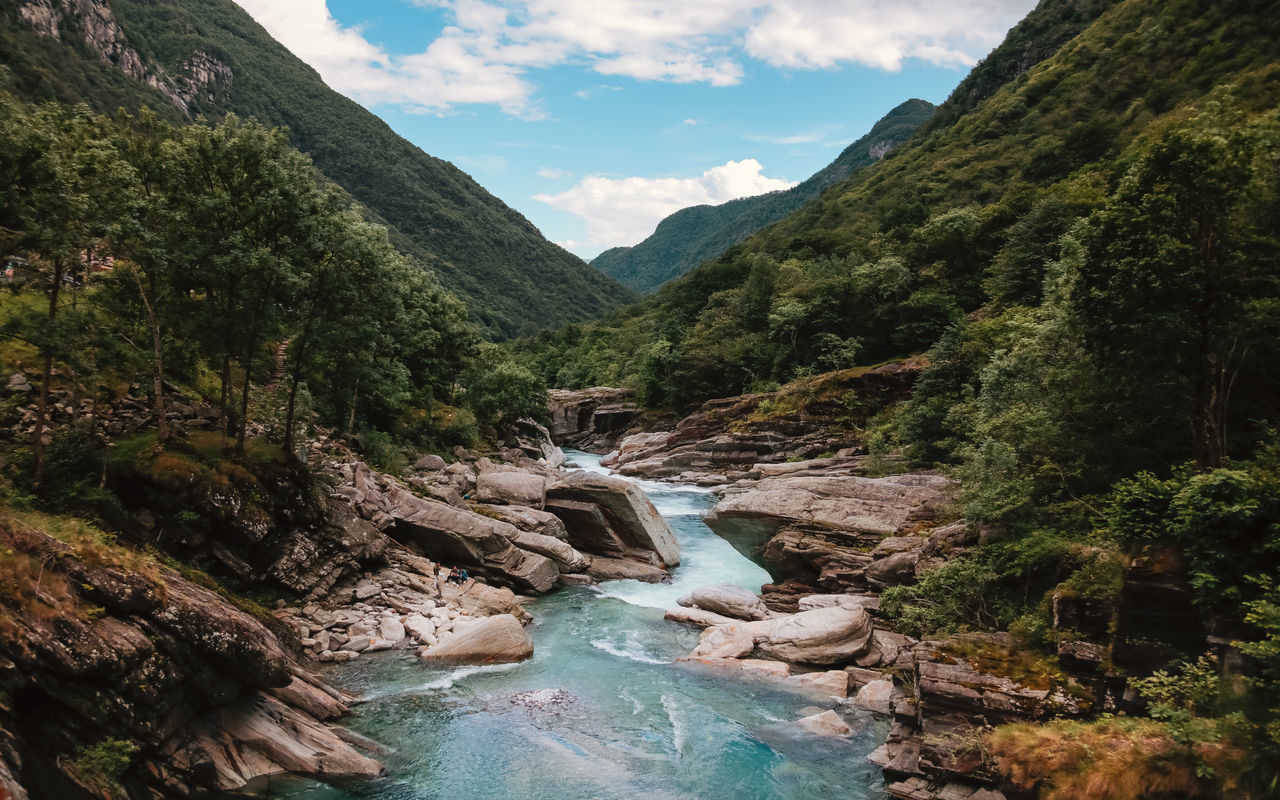 beauty in nature, nature, mountain, scenics, tranquil scene, river, water, day, idyllic, tranquility, sky, tree, outdoors, waterfall, no people, motion, landscape, forest