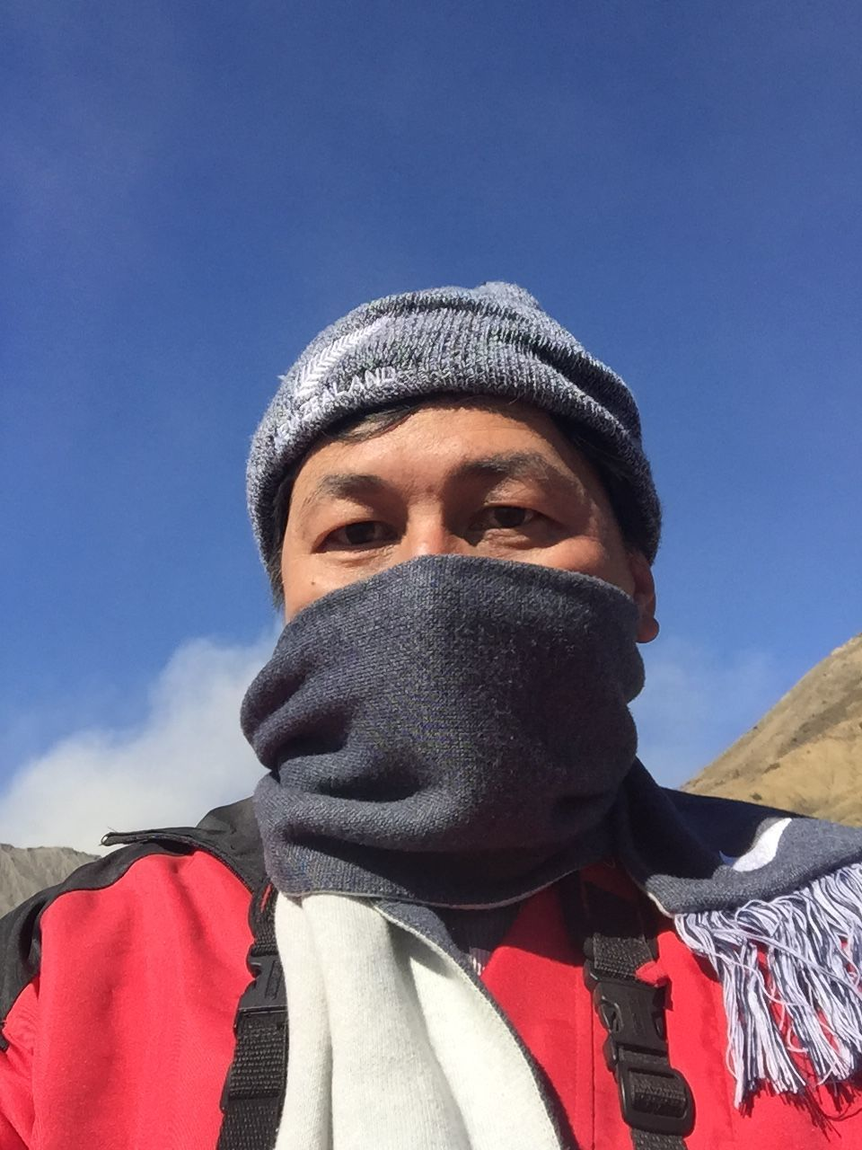 one person, day, low angle view, real people, headshot, leisure activity, front view, lifestyles, outdoors, young adult, looking at camera, portrait, sky, clear sky, men, close-up, warm clothing, people