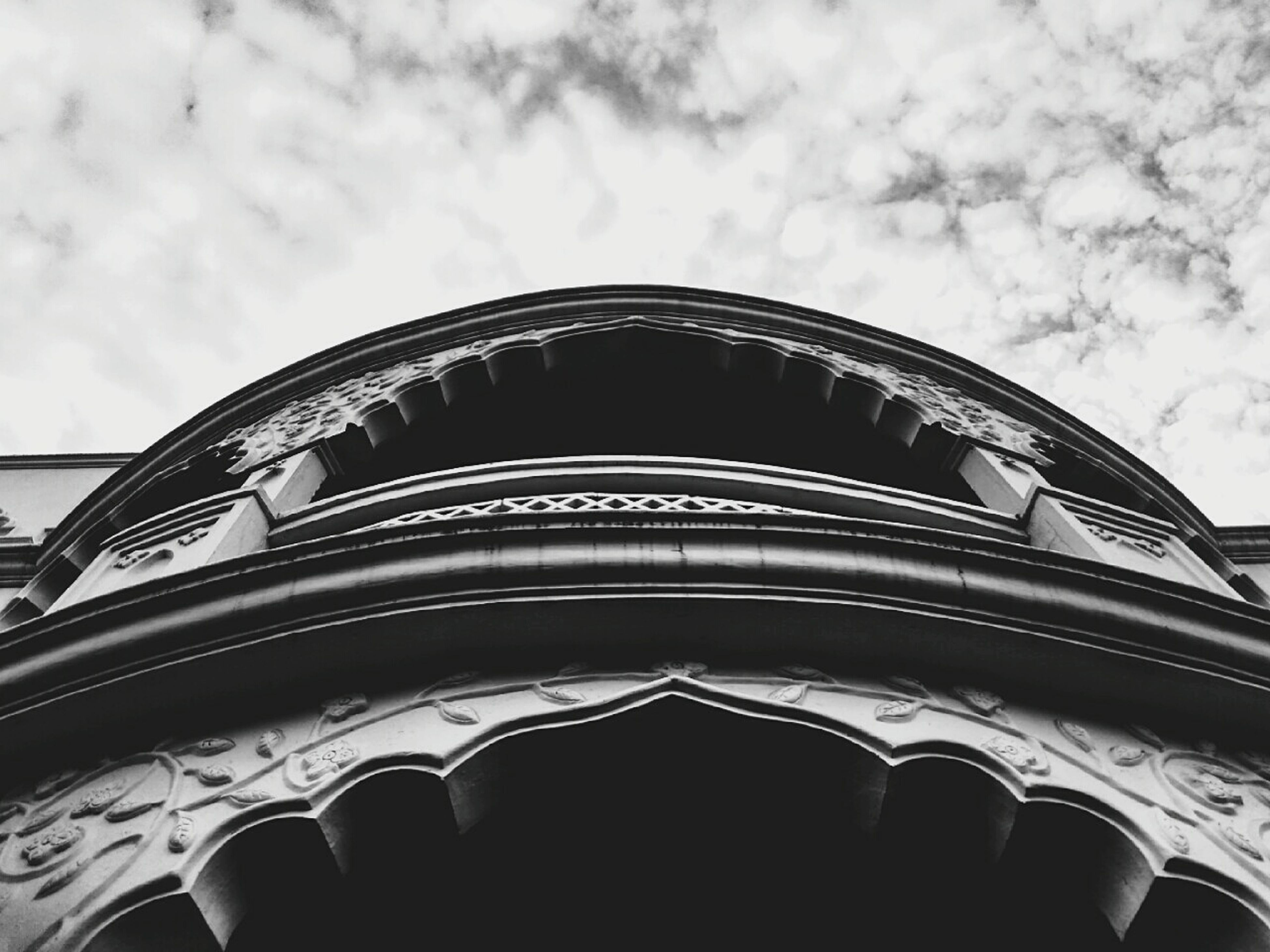 low angle view, architecture, sky, built structure, building exterior, cloud - sky, arch, cloud, cloudy, dome, outdoors, day, no people, high section, facade, building, window, architectural feature, part of, pattern