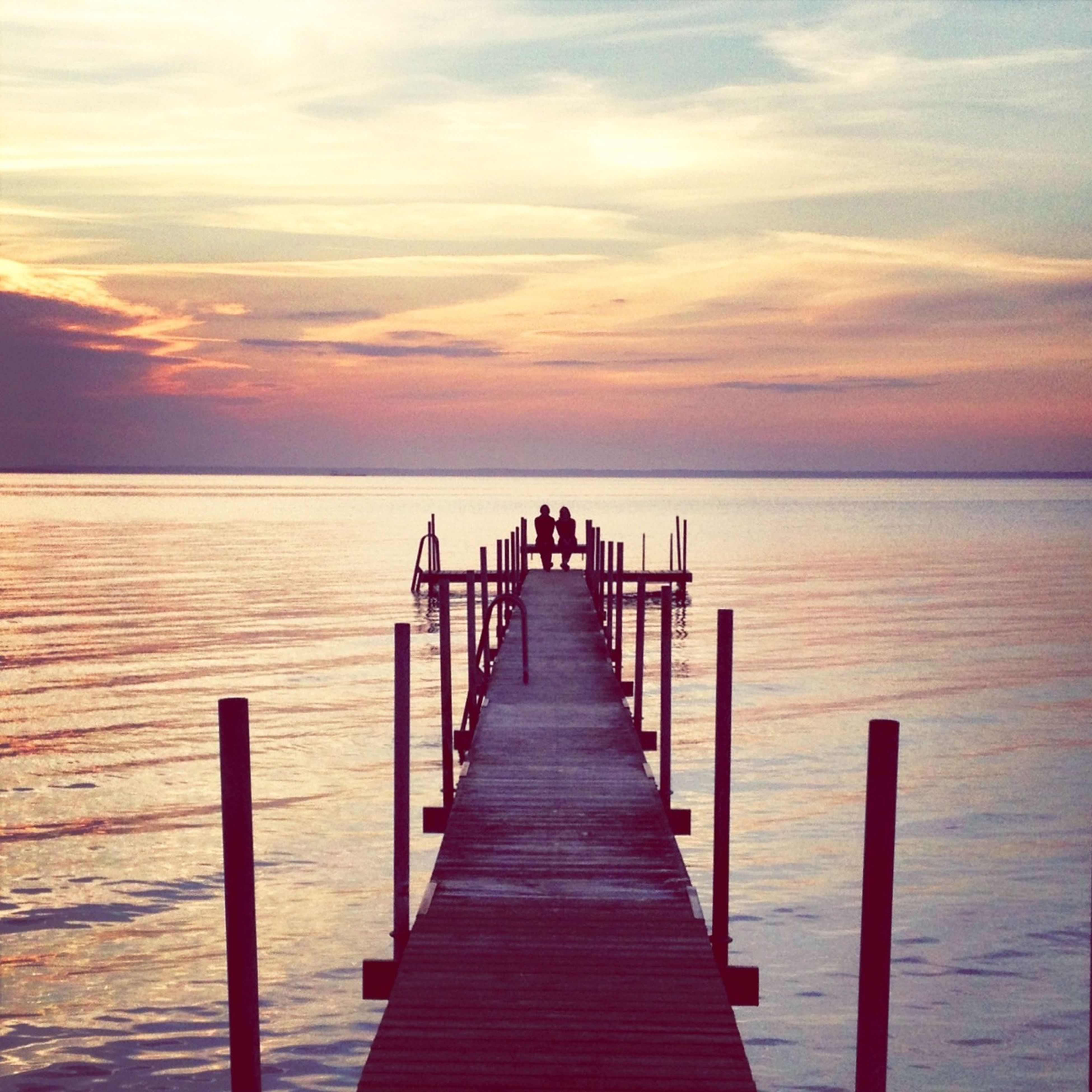 pier, sea, water, tranquil scene, sky, tranquility, horizon over water, scenics, the way forward, wood - material, sunset, beauty in nature, jetty, nature, railing, idyllic, cloud - sky, diminishing perspective, long, boardwalk