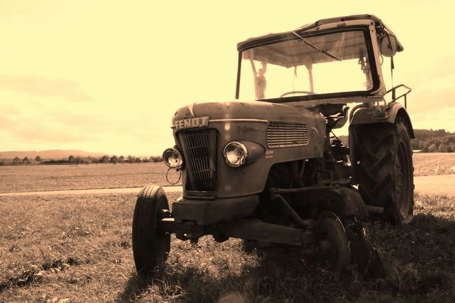 Abandoned Agriculture Beauty In Nature Combine Harvester Day Field Land Vehicle Landscape Mode Of Transport Nature No People Old-fashioned Outdoors Scenics Sky Sunset Tractor Transportation