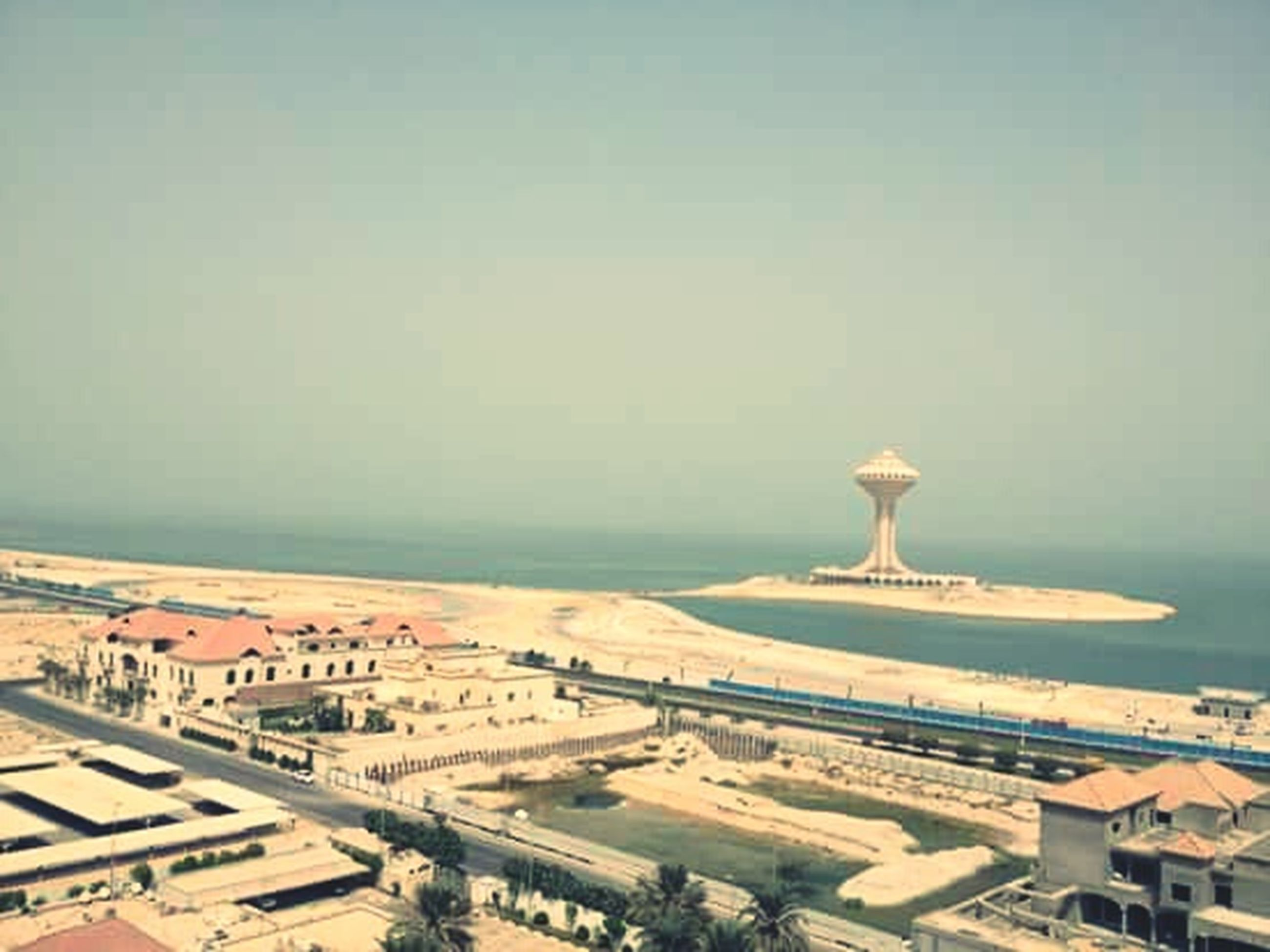 sea, horizon over water, copy space, water, clear sky, beach, built structure, sky, architecture, shore, day, sand, tranquil scene, tranquility, nature, outdoors, scenics, no people, building exterior, ocean