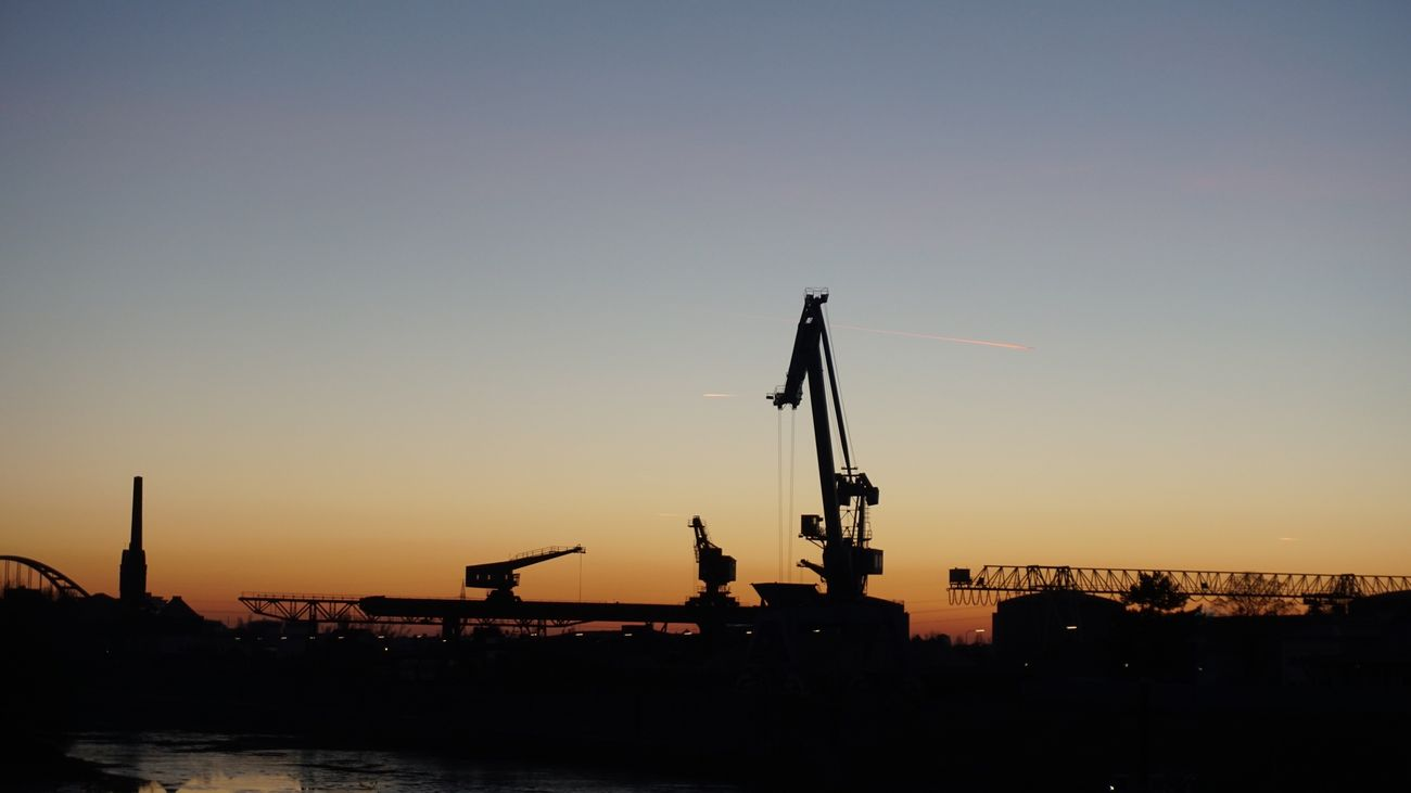 At the waterfront No. 6/9. Copy Space Sunset Silhouette Industry Transportation Clear Sky Outdoors Sky No People Construction Nature Water Day Crane Brigde ❤️ Düsseldorf Waterfront Harbour Water Reflections