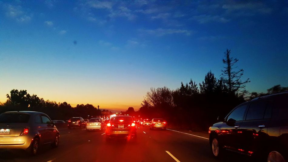 Car Mode Of Transport Transportation Travel Driving Traffic Road Sunset Land Vehicle Illuminated Rush Hour Tree No People Nature Sky Night Brake Lights