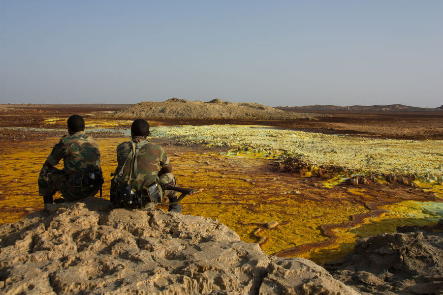 Africa Beauty In Nature Danakil  Danakil Depression Ethiopia Idyllic Landscape Lifestyles Nature Non-urban Scene Outdoors Rock - Object Scenics Sitting Soldiers Tourism Tranquil Scene Travel Destinations Vacations