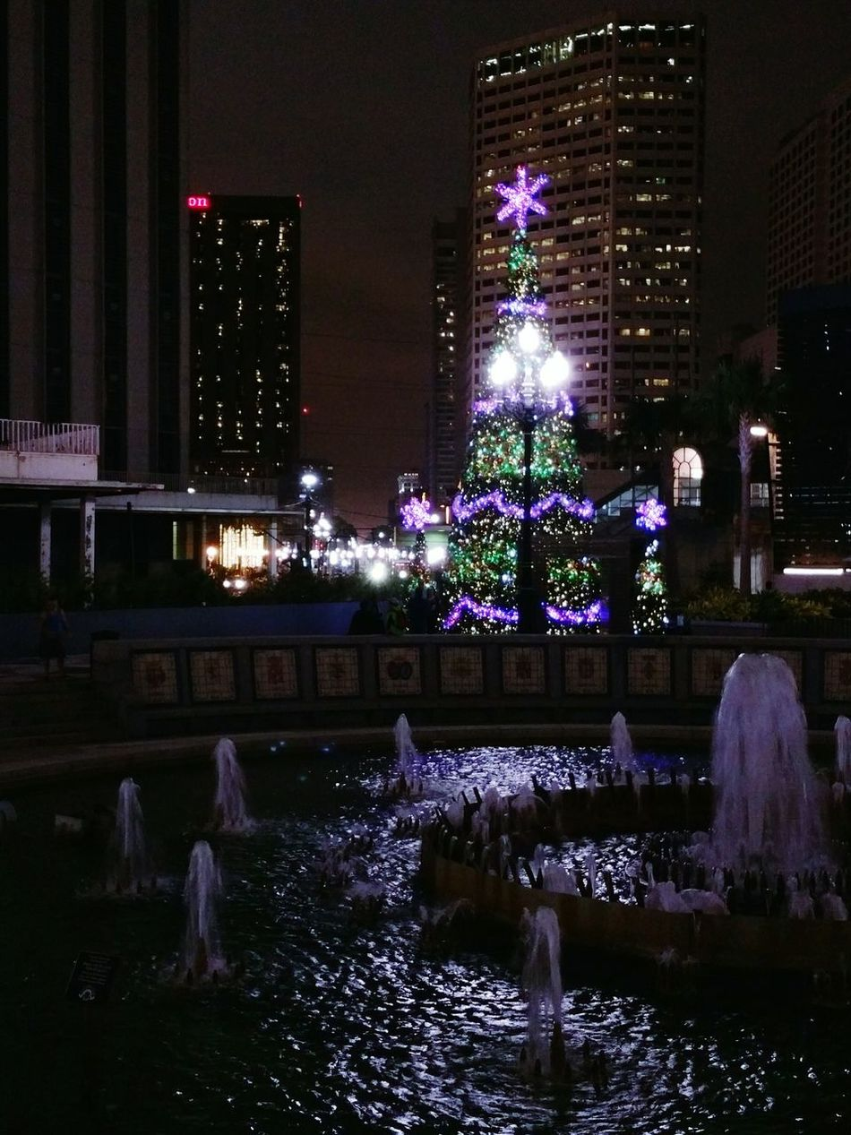 Christmas Tree in Spanish Plaza in New Orleans, Cityscape with Canal Street in background, City Life Urban Landscape Walking Around The City  Fountain Cities At Night