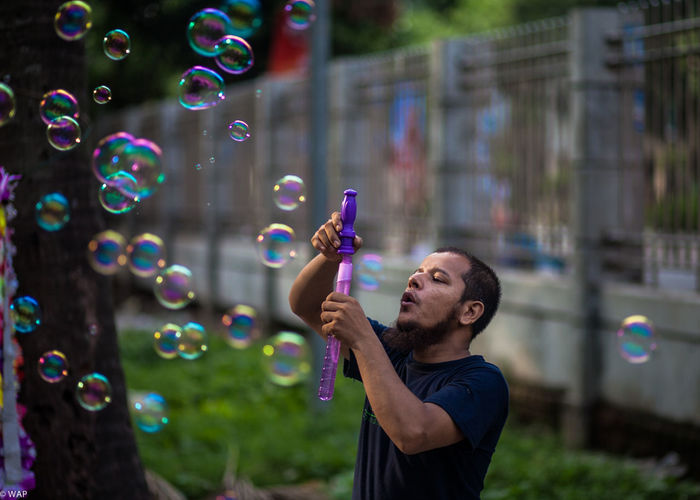 Bubble Gun SellerBubble People Street Vendor Bubble Gun