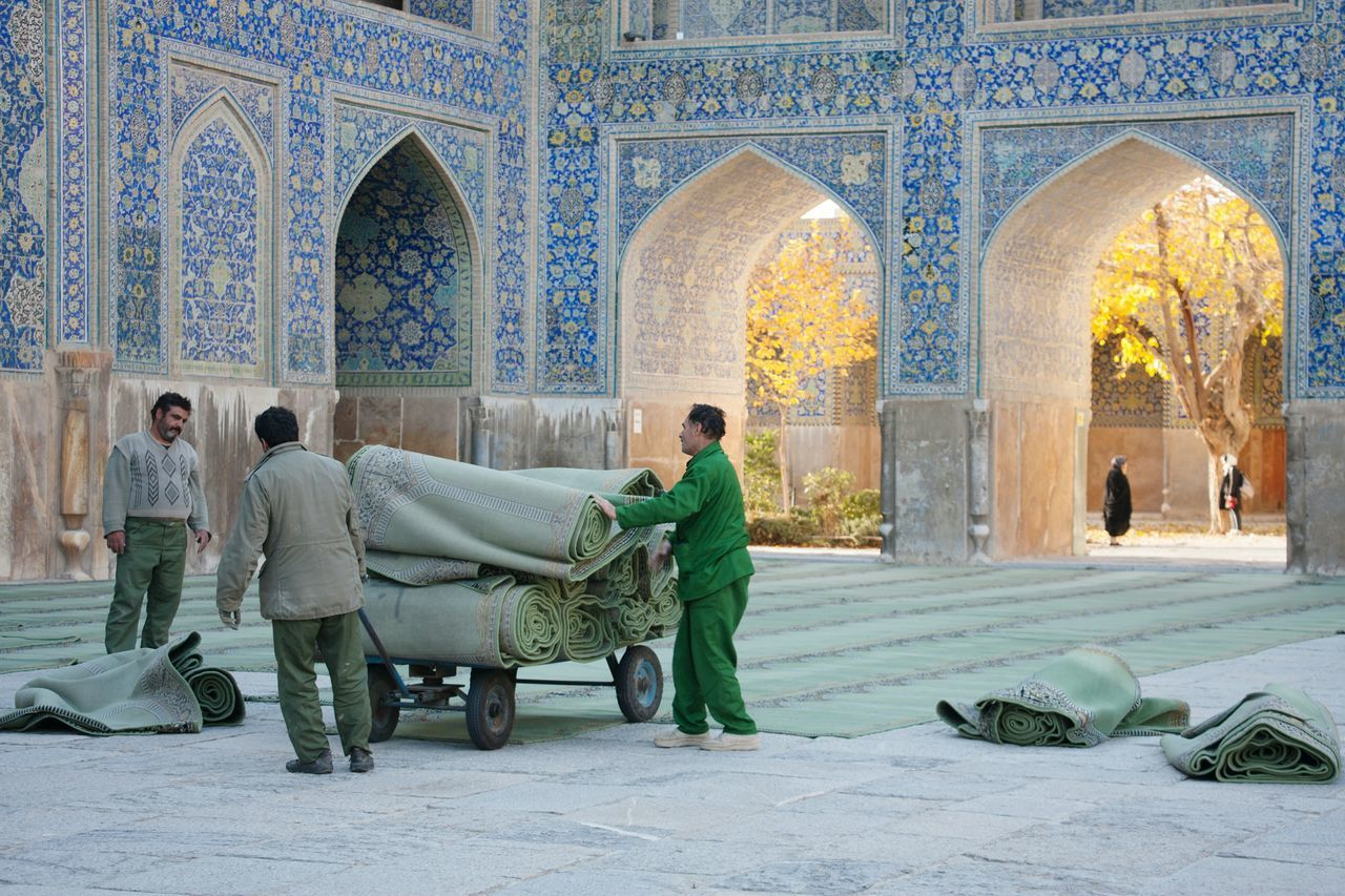 Collected Community of Men putting out the hundreds of Prayerrugs (aka Sajadah) in the Shahmosque , Naghshe Jahan Square, Isfahan,IRAN. Nofilter Eyeemtravel  OpenEdit