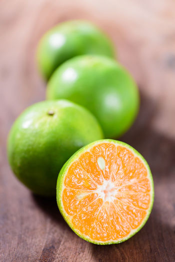 Tangerine orange fruit Diet Freshness Mandarin Oranges Citrus Fruit Day Food Food And Drink Fresh Freshness Fruit Green Color Health Healthy Eating Healthy Food Healthy Fruit Indoors  Ingredient Juicy No People Orange Fruit Ripe Fruit SLICE Table Tangerine Wood - Material