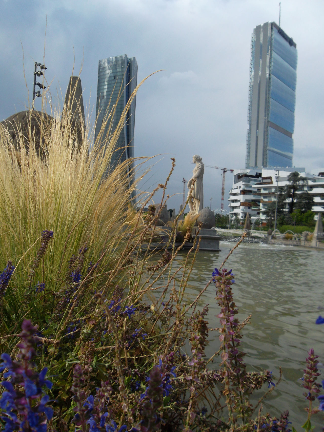 Citylife ... Arata Isozaki Architecture Building Exterior City Day Fontana Delle Quattro Stagioni Grass Growth Lake Milano Citylife Nature No People Outdoors Plant Sky Skyscraper Travel Destinations Water Zaha Hadid