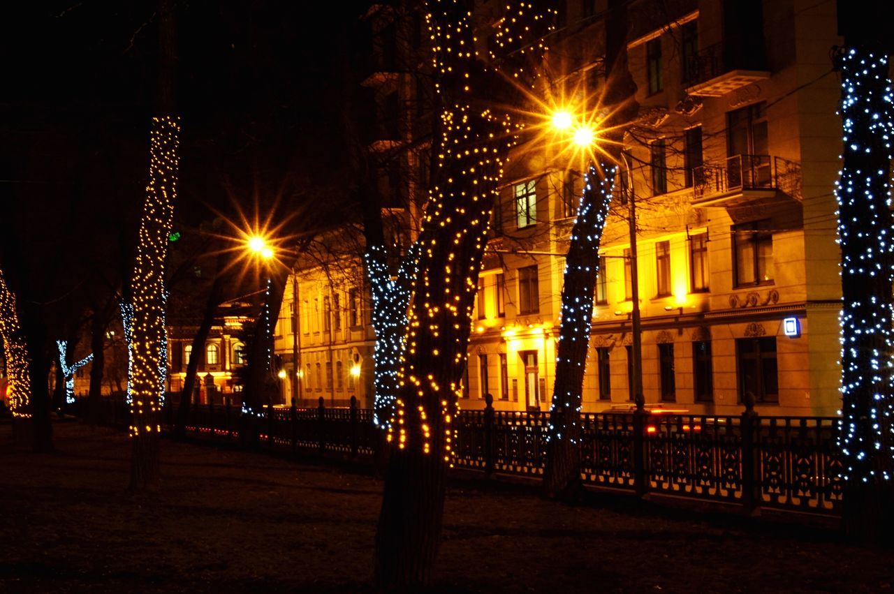 illuminated, night, lighting equipment, glowing, electric light, architecture, electricity, street light, built structure, building exterior, christmas lights, no people, city, low angle view, outdoors, christmas decoration, sky