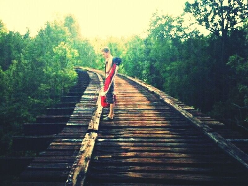 My hubby walking across the train trussle My Hubby Trussle Train Tracks