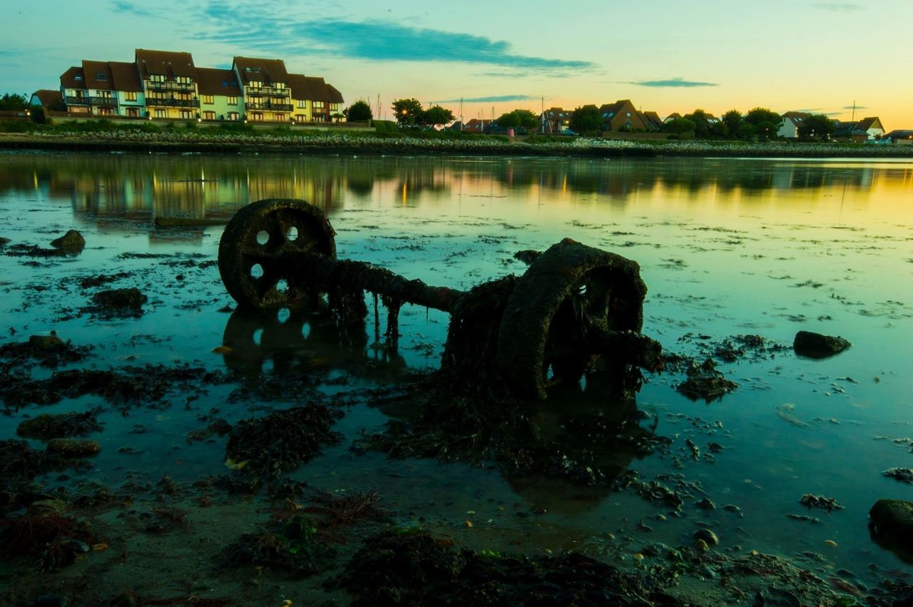 Rusty wheels on the sea shore at sun rise.. Around You Nearby Hythe Southampton Docks Sunrise The Golden Hour Water Built Structure Outdoors Nature Nautical Vessel No People Architecture Sky Day Reflections Water Reflections