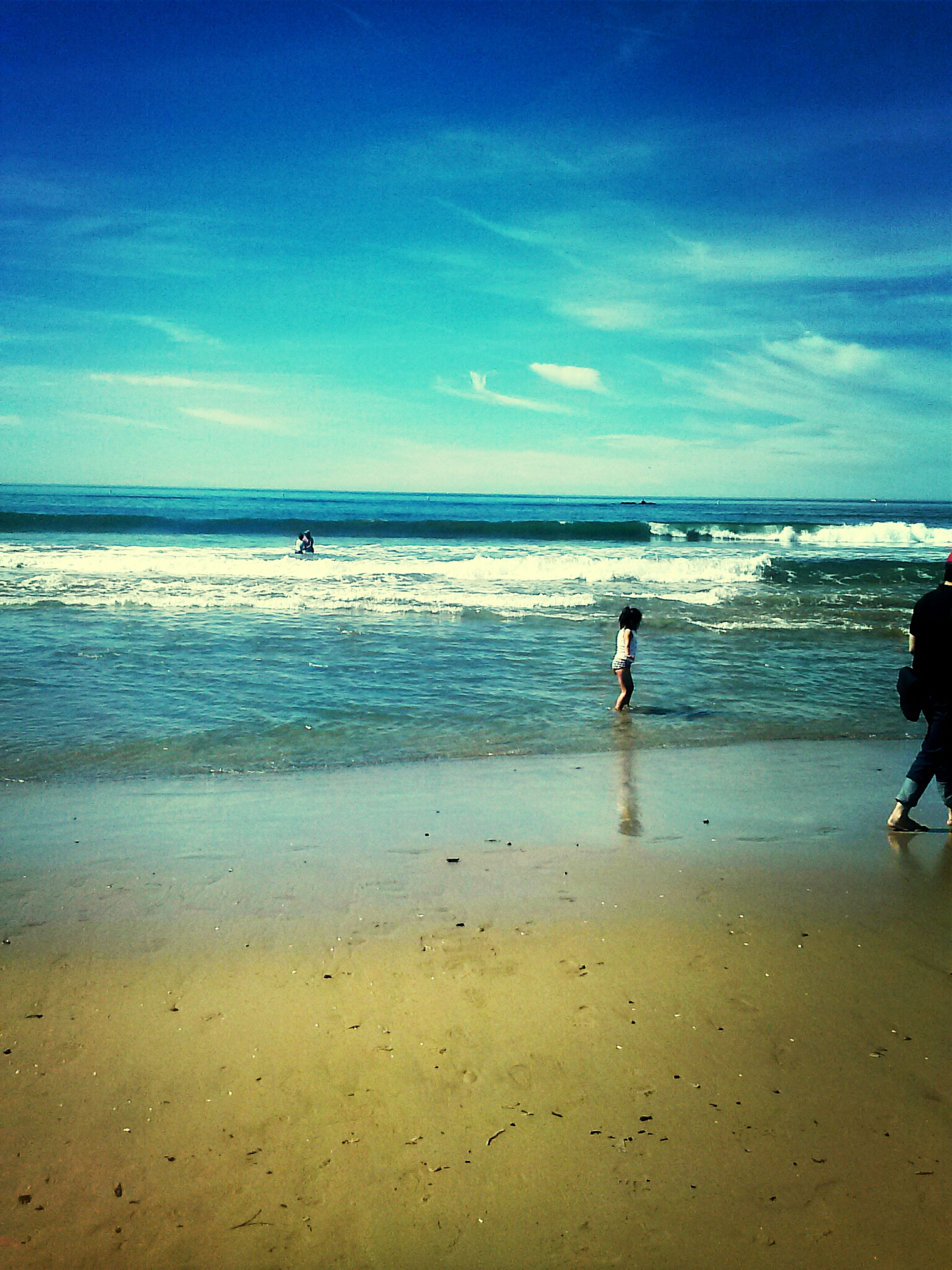 sea, beach, horizon over water, water, shore, vacations, tranquil scene, scenics, sand, tranquility, tourism, sky, wave, tourist, beauty in nature, summer, coastline, travel, tide, idyllic, leisure activity, calm, travel destinations, nature, weekend activities, non-urban scene, blue, seascape, ocean, cloud
