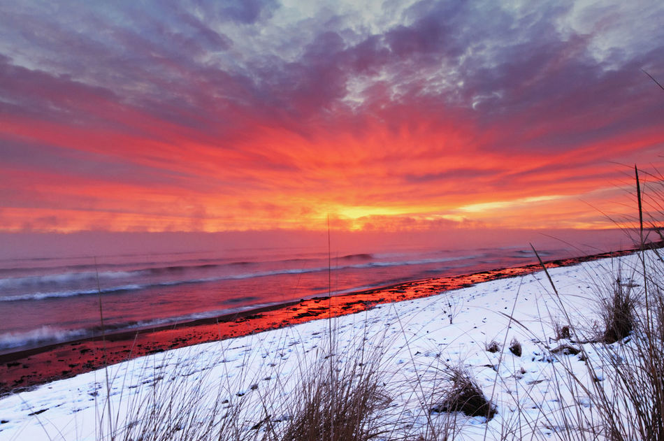 Early morning sunrise on Lake Superior. Beauty In Nature Cloud - Sky Cold Cold Temperature Duluth Minnesota USA Lake Superior Landscape Morning Morning Sky Nature No People Orange Sky Outdoors Park Point Beach Scenics Sky Snow Sunrise Sunrise And Clouds Warm And Cool Colors Water Weather Winter EyeEmNewHere