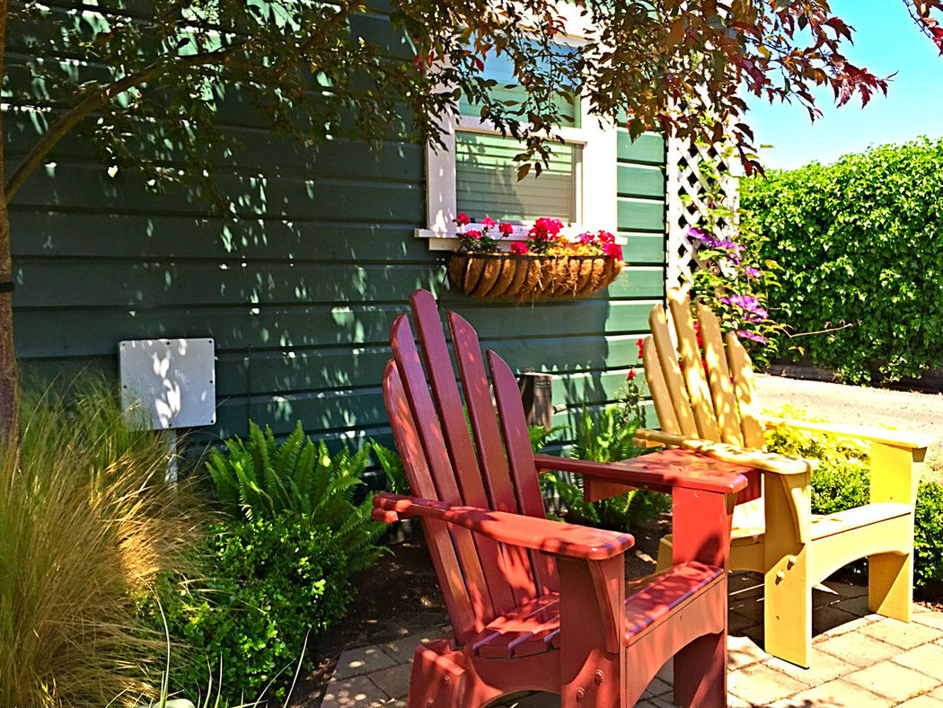 Adirondack Chairs Day Empty Front Or Back Yard No People Outdoors Patio Red Chair Restful Place Sunlight Yellow Chair The Essence Of Summer