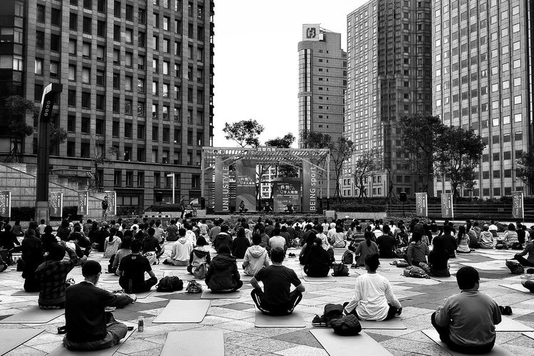Yoga Yogaeverywhere City Large Group Of People People Women Crowd Social Issues Skyscraper Adult Outdoors Adults Only Day Citylife Landscape Taking Photos City People And Places People Watching Capture The Moment Cityscape Streetphotography City Life People Together B&w Street Photography