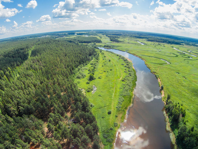 "The view from the height of the river Mologa in the area Lounges ""Lomovskii beach"" Aerial Aerial View Cloud - Sky Day Dronephotography Green Color Landscape Mologa Nature No People Outdoors Reflection River Russia Scenics Sky Sunny Tourism Travel Water"