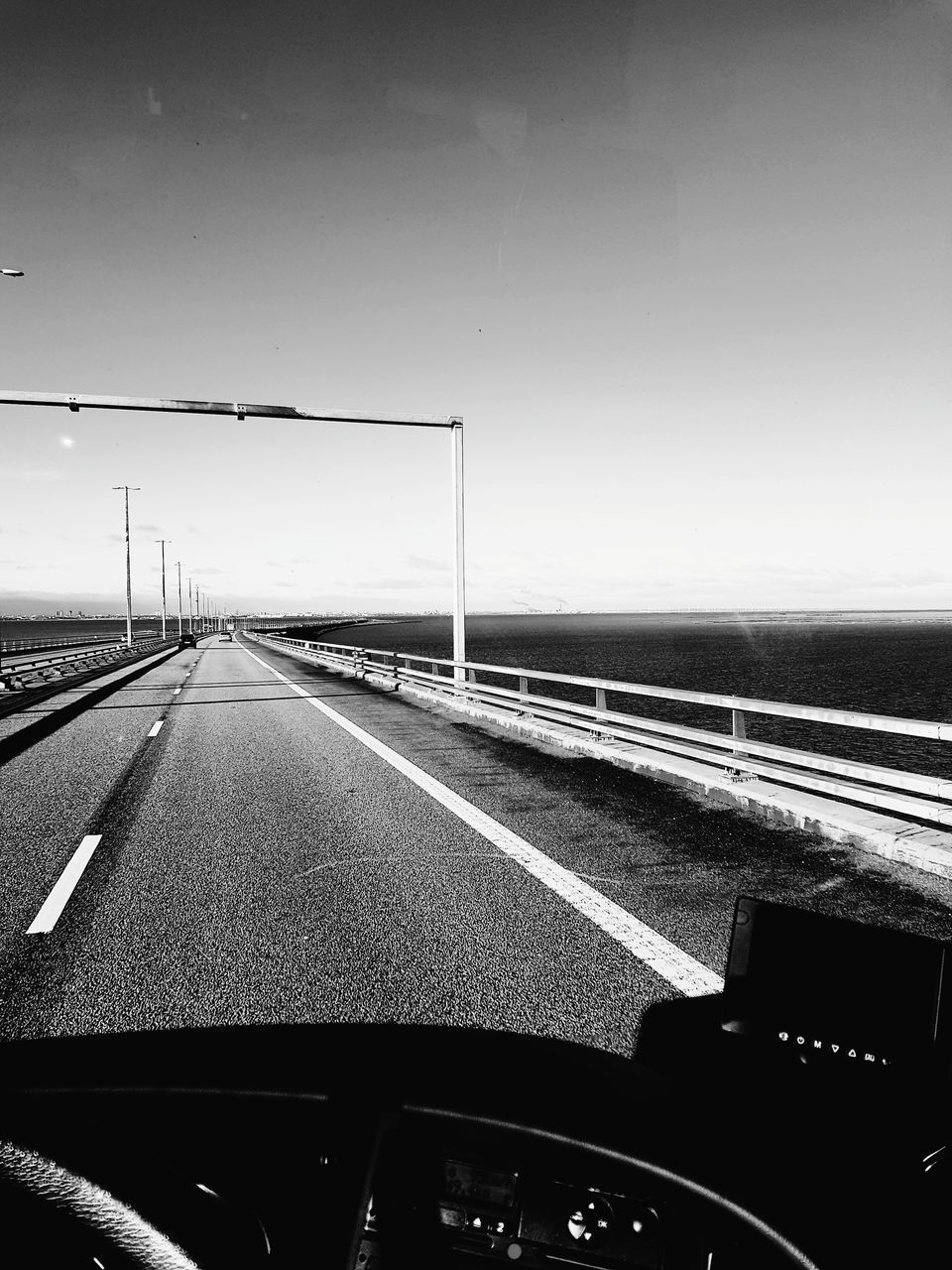 transportation, road, car, vehicle interior, car interior, the way forward, highway, windshield, land vehicle, car point of view, mode of transport, empty, dashboard, driving, street, no people, day, sky, speedometer, outdoors