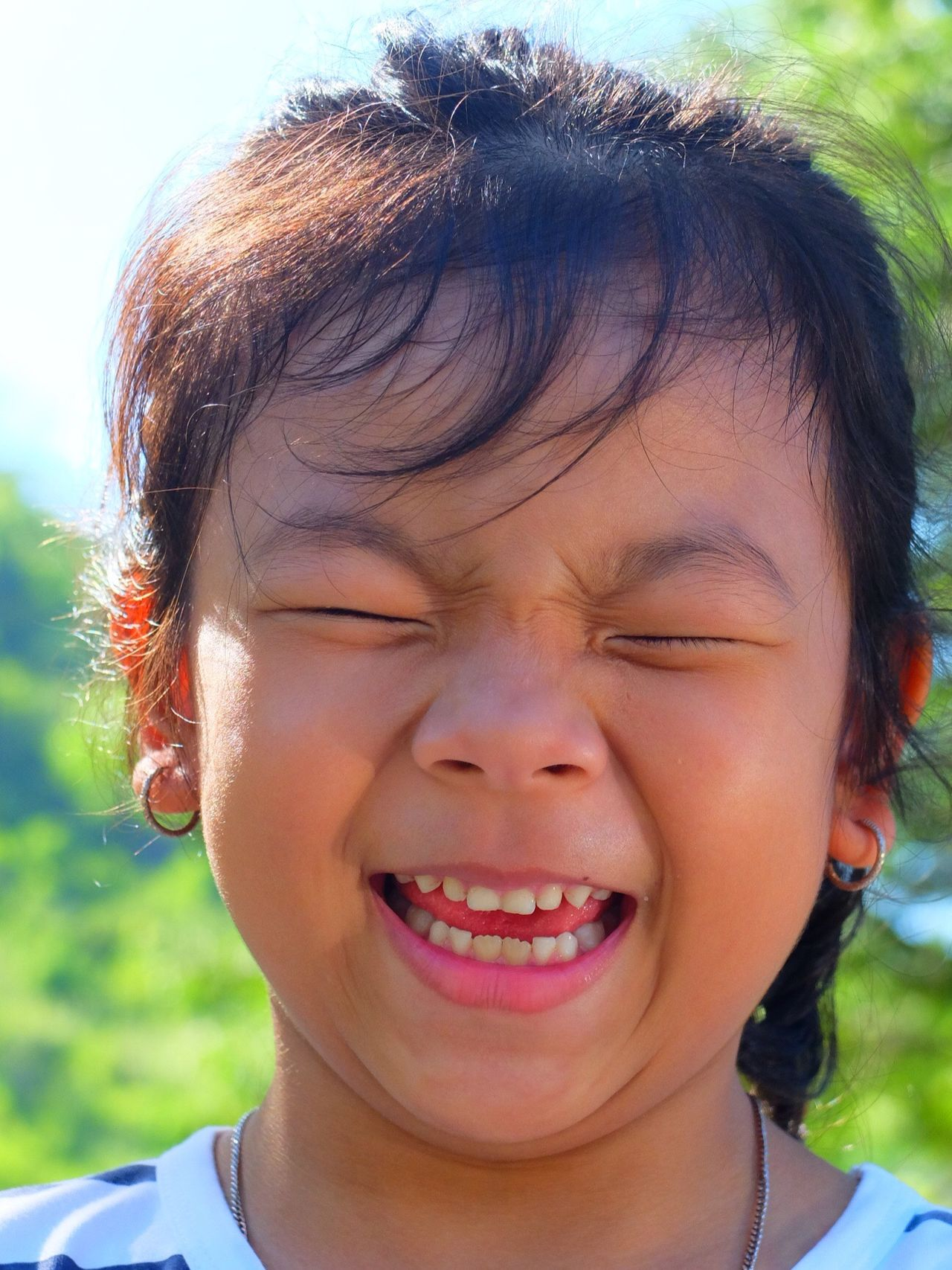 Art Is Everywhere Girls Asian Girl Asiangirl One Girl Only Black Hair Child Childhood Smile Loughing Lough Bokeh Green Background Tree Teeth Tounge Out