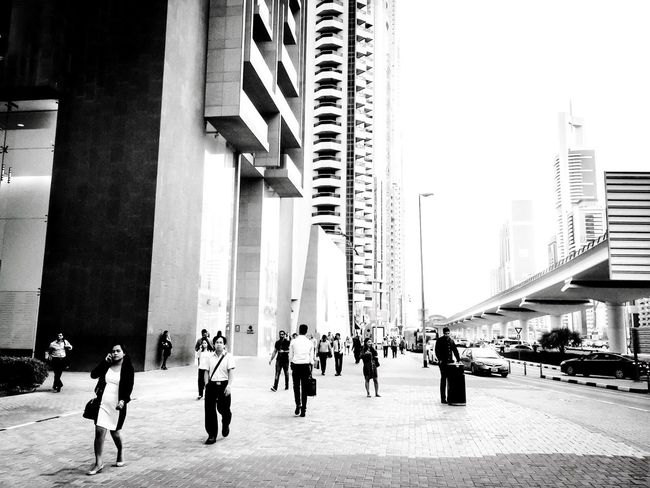 Business as usual - Financial District in Dubai The Street Photographer - 2016 EyeEm Awards Blackandwhite Streetphotography UAE Dubai Urban Geometry The Photojournalist - 2016 EyeEm Awards Business Outdoors Urban Urbanphotography Urban Landscape Taking Photos Architecture Coffee Please EyeEm Best Shots Black And White Streetphoto_bw Envision The Future