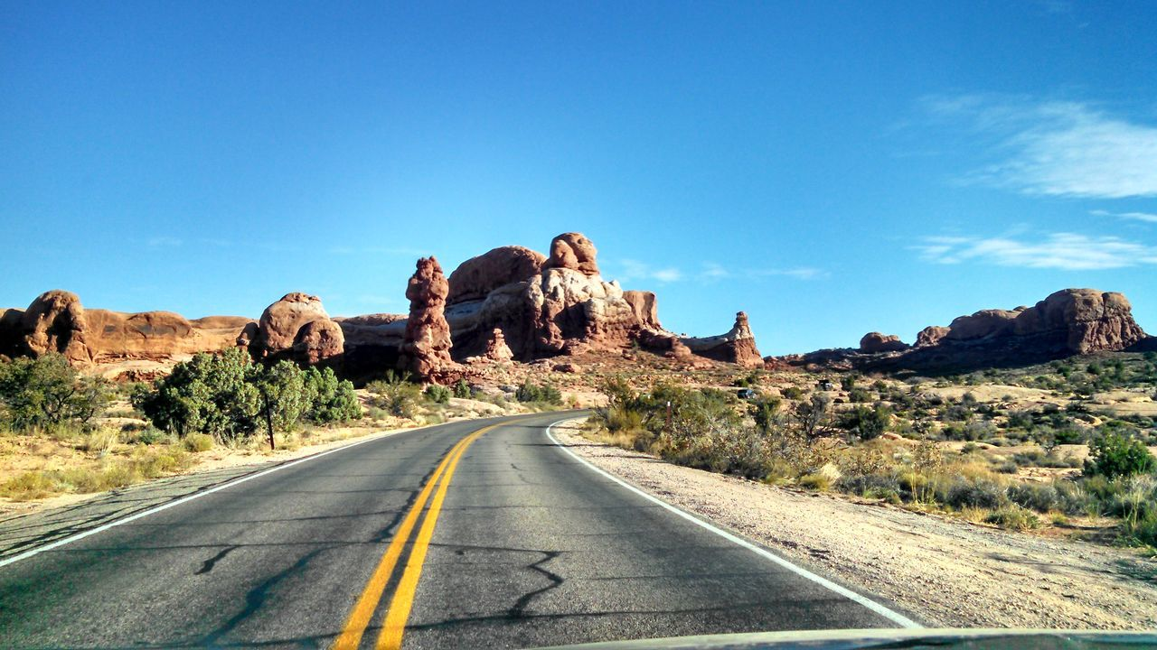 #arches #nationalpark #redrock #Utah Blue Clear Sky Country Road Desert Diminishing Perspective Landscape Mountain Nature Non-urban Scene Road Road Marking Rock - Object Rock Formation Scenics Sky The Way Forward Tranquil Scene Tranquility Transportation Vanishing Point