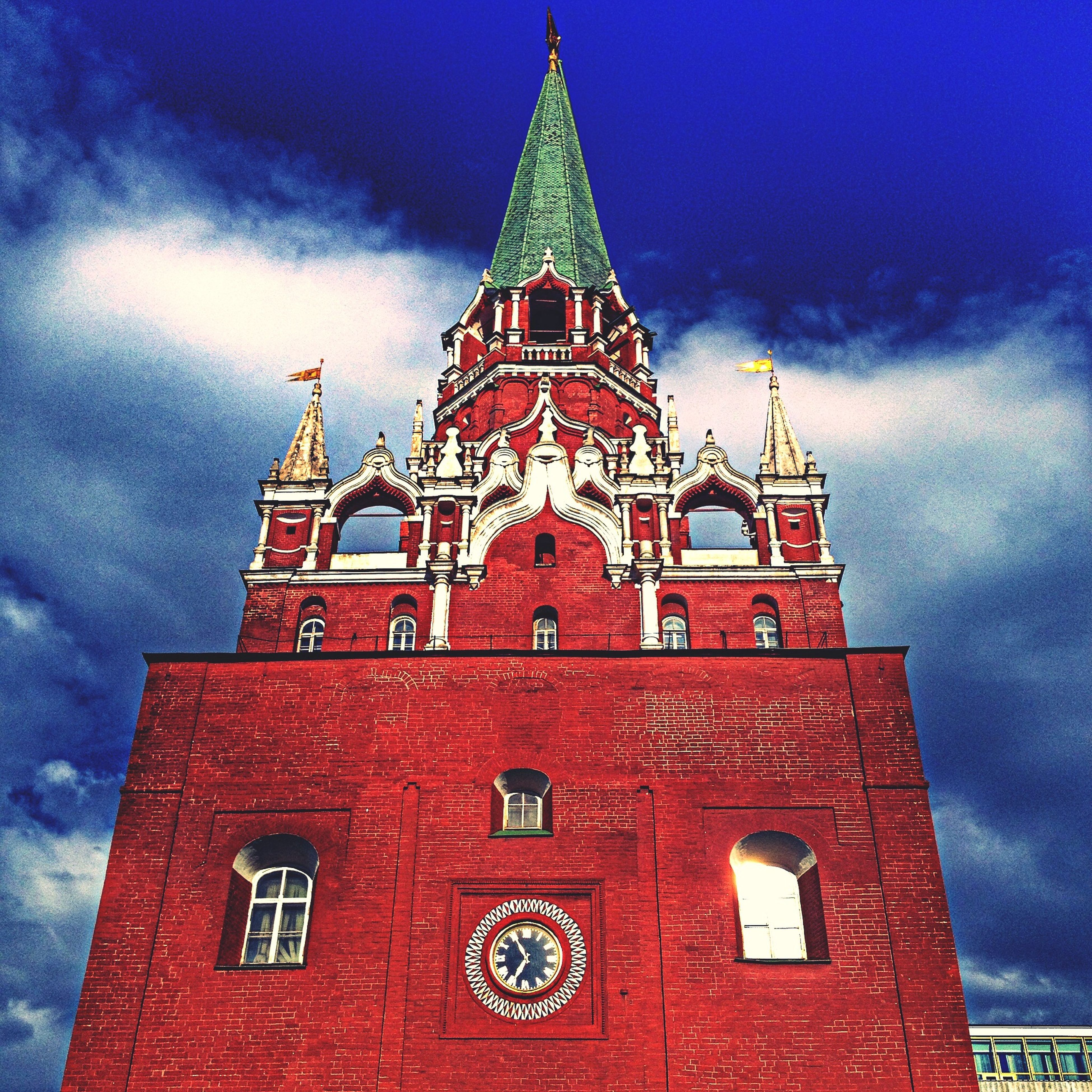 architecture, building exterior, low angle view, built structure, sky, red, religion, cloud - sky, church, place of worship, tower, spirituality, cloudy, clock tower, cloud, day, outdoors, no people