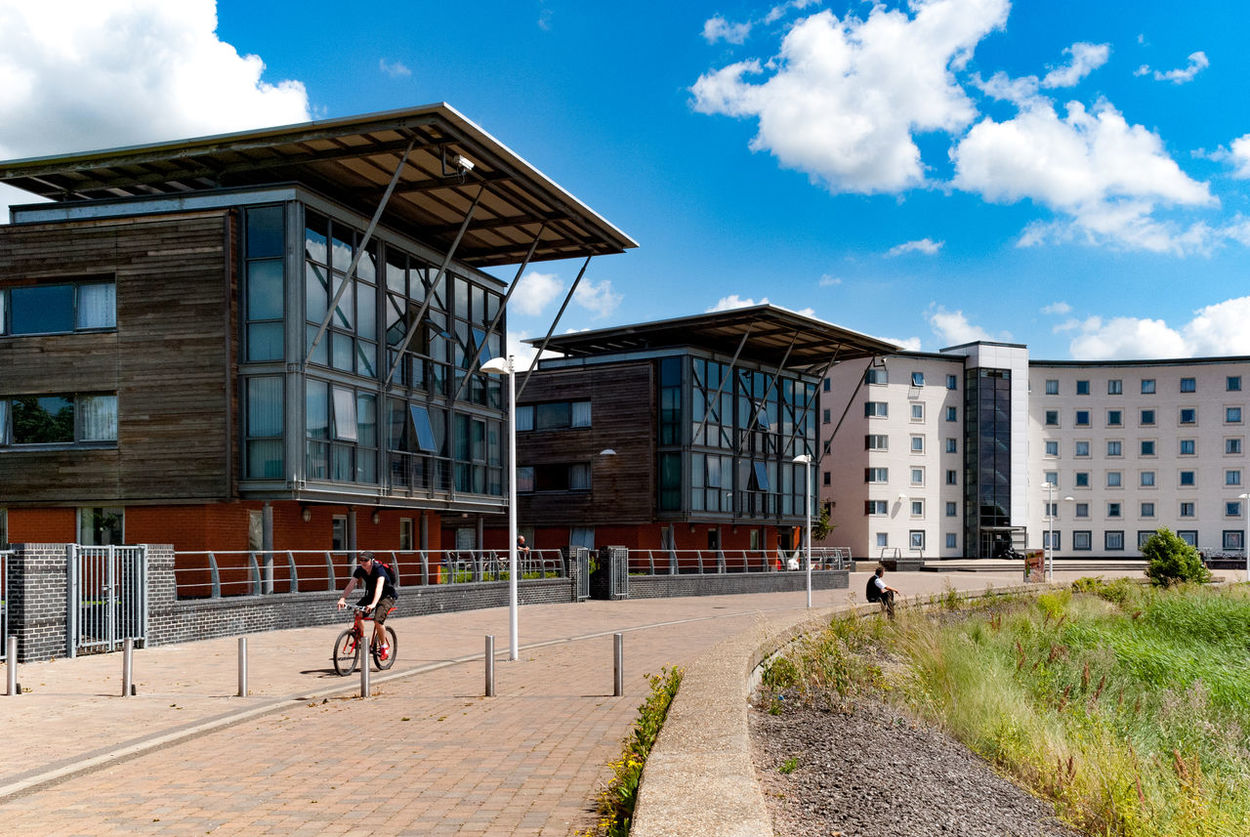 Cyclist Architecture Blue Sky Building Exterior Built Structure Cloud - Sky Day Essex University Grass Men Nature Outdoors People Real People Sky Student Accommodation