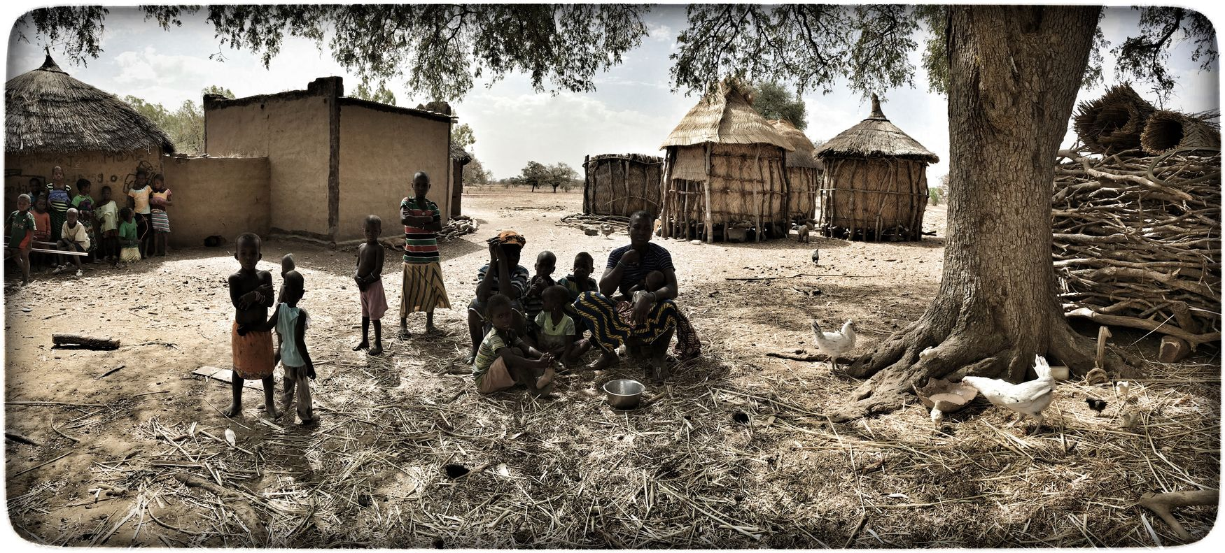 Dorf in Burkina Faso Architecture Building Exterior Built Structure Day House Large Group Of People Mammal Men Outdoors People Real People Sky Tree Village