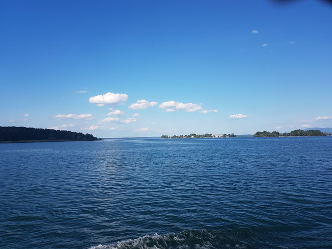 Sea Blue Sky Outdoors Vacations Water No People Nature Clear Sky Travel Destinations Landscape Summer Beauty In Nature Chiemsee