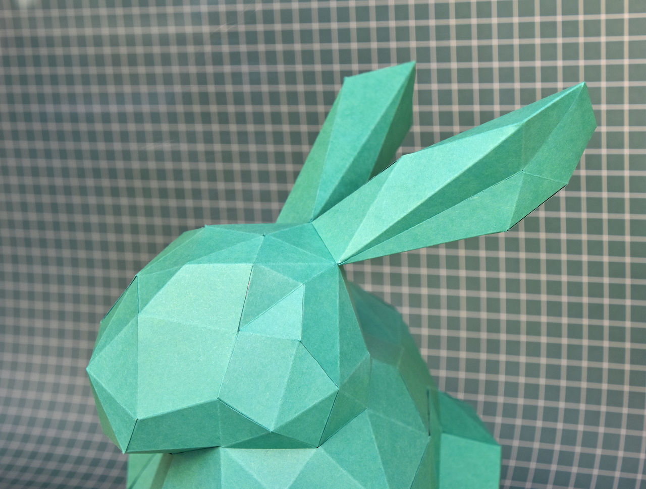 Paper handycraft, green rabbit over checkered background Background Checkered Pattern Close-up Easter Easter Ready Easter Sunday Geometric Geometric Art Green Color Greenery Handmade Handycraft Hobby No People One Person Paper Paper Art Paper View Papercraft Paperwork Rabbit