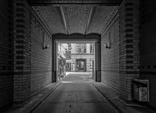 Alley Arch Architecture B&w Backyard Black And White Building Exterior Built Structure City Day Diminishing Perspective Empty Entrance Entrance Gate Footpath Hauseinfahrt Hinterhof Kreuzberg Long Narrow Pathway Paving Stone Street The Way Forward Walkway